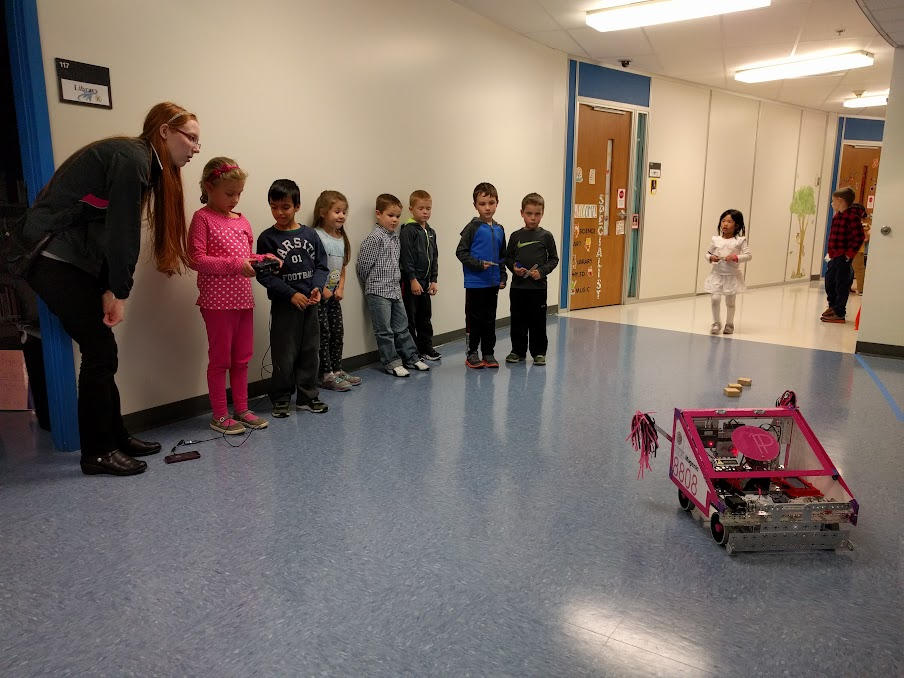 Meghan helping the kindergartners drive the robot