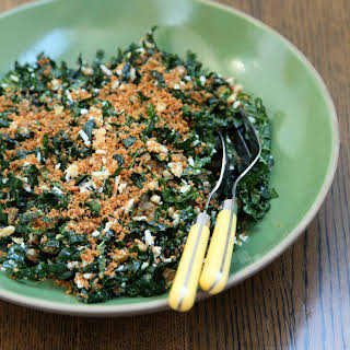 Kale Salad With Walnuts, Golden Raisins, and Toasted Breadcrumbs.
