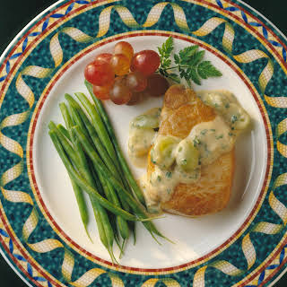 Sauteed Pork Chops in Savory Grape-Mustard Sauce.