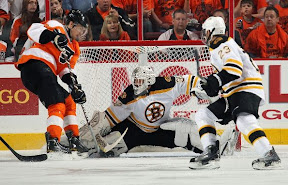 Tim Thomas makes a save