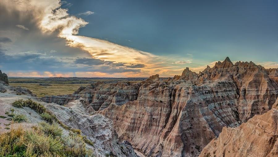 Badlands Sunset by Craig Pifer - Landscapes Mountains & Hills ( clouds, hills, badlands national park, national park, mountains, sky, sunset, south dakota, landscape, badlands, sun )