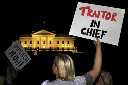 Protesters rally outside the White House in Washington on July 16 2018, after US President Donald Trump's return from a meeting with Russian President Vladimir Putin in Helsinki, Finland. Picture: REUTERS