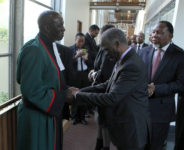 Deputy Judge President Dikgang Moseneke (L) is greeted by former President Thabo Mbeki at the justice's farewell at the Constitutional Court on Friday. Former president Kgalema Motlanthe looks on. Picture: GCIS