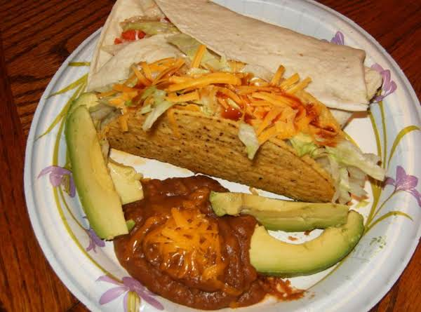 Judy's Tacos And Burritos, Served With Refried Beans And Avacado Slices.