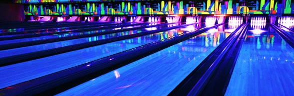 glow-in-the-dark blue bowling lanes with purple pins