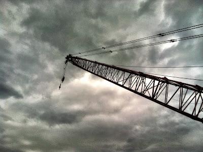 Ominous dark clouds crane boom photo