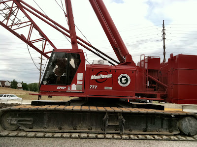 Red crane construction site photo