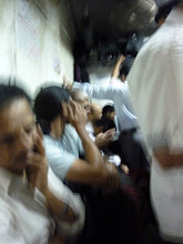Photo: Richard Kher and the top of Ketan Vaidya's head (Taklu) sitting on the train during the 2.5 hour journey to Asangaon on a fast local train.