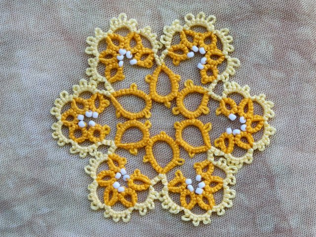 Tatted yellow and orange snowflake