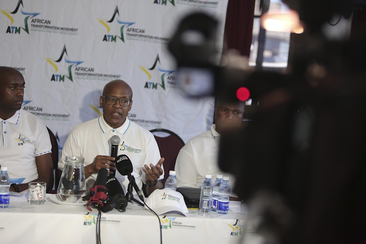 Mzwanele Manyi talks to members of the media and supporters of new political party African Transformation Movement.