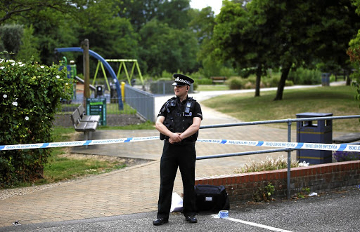A police officer guards the entrance to Queen Elizabeth Gardens, which has been cordoned off after two people were hospitalised and police declared a 'major incident', in Salisbury, UK, July 4 2018. REUTERS/Henry Nicholls