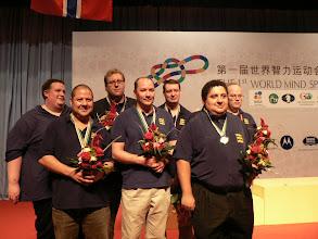 Photo: Open Team     From left to right:     Simon Cope (Coach), Justin Hackett, David Gold, Nick Sandqvist, Tom Townsend, Jason Hackett, Phil King (Captain)