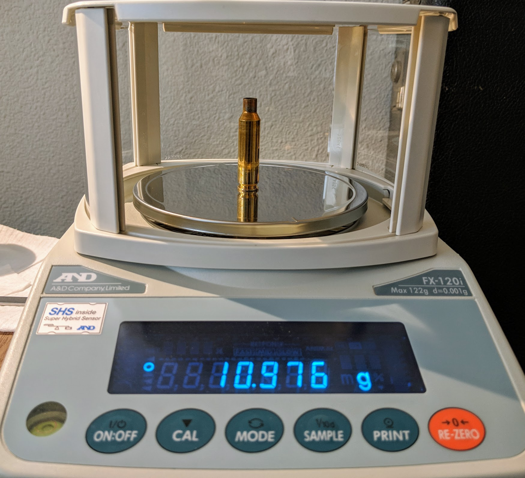 Weighing a clean, empty brass case.