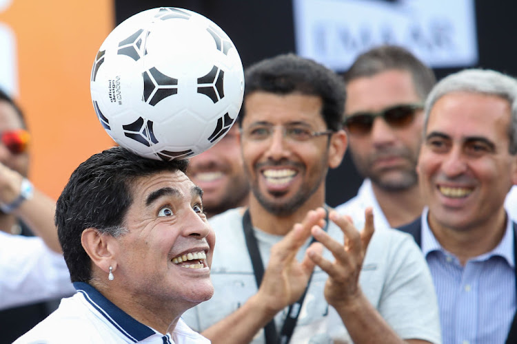 Soccer icon Diego Maradonna shows off his skills. The athlete is the focus of the documentary, Maradonna, by filmmaker Asif Kapadia who looks into his career as one of the most celebrated soccer stars.