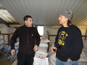 Photo: Matt Clarke (left), head brewer for Hawkshead, discusses malt and hops with Spike Buckowski of Terrapin Beer Company in Athens, Georgia.