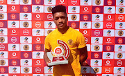 Dumisani Zuma accepts his Goal of the Month trophy.