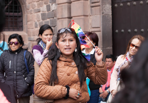 A Peruvian guide outside the Koricancha sacred complex in Cusco, Peru.