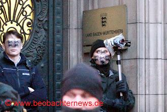 Photo: Polizeifilmer im Einsatz.