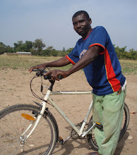"""Photo: Gatah is a farmer from the village of Dupari. He says, """"I am very happy I will own a bicycle.  I will use my bike to carry heavy loads, which is much easier and quicker!"""""""