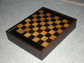 Photo: CH191: rosewood board box - the underside of the board is a 10x10 square board