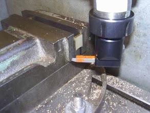 Photo: Usinage des pieds de fixation de la chaudière. Le rayon est celui du tube de la virole.