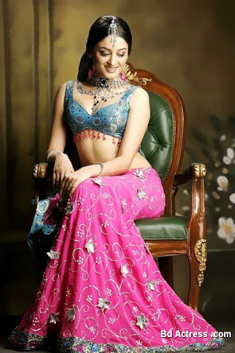 Indian Model Mahi Vij sitting on chair