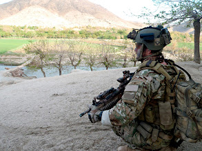 Photo: A Special Forces soldier scans the terrain near a village in Uruzgan. Mid Caption:Afghan police and their Special Operations Task Group (SOTG) partners have continued a successful spring campaign by capturing two prominent insurgents from separate districts. Members of the Provincial Response Company Uruzgan (PRC-U) and SOTG captured a high value target in the Deh Rafshan area near Tarin Kot and another in North Uruzgan's Char Chineh district. Australian Special Forces have now removed thirteen key Taliban targets since high tempo operations began in March. Deep: The Special Operations Task Group is deployed to southern Afghanistan to conduct population-centric, security and counter network operations. SOTG support the Afghan National Police's Provincial Response Company in Uruzgan and northern Kandahar. SOTG includes members from the Special Air Service Regiment (SASR), 1st and 2nd Commando Regiments, the Incident Response Regiment, Special Operations Logistic Squadron and supporting units.