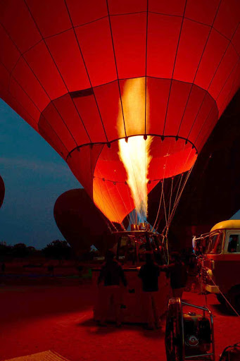Myanmar-balloon-flame.jpg - A hot air balloon prepares for liftoff in Bagan, Myanmar.