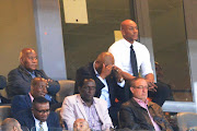 A file photo of Kaizer Chiefs' chairman Kaizer Motaung (L) , football manager Bobby Motaung (C) and former player Kaizer Motaung Jnr look on during an Absa Premiership match.
