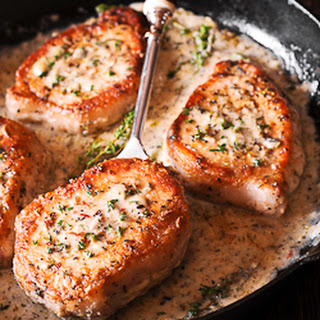 Pork Chops in Creamy Garlic and Herb Wine Sauce.