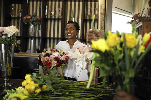In a time of high demand, Andrew Masibuko attends to roses at Jason's Flowers at Multiflora flower market, in Johannesburg. Picture: Alon Skuy