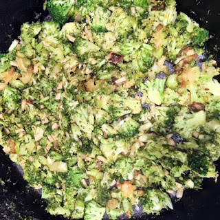"""Charred and Roasted Broccoli with Toasted Slivered Almonds and """"Cheese""""."""