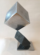 Photo: BALANCING ACT 4 - CUBE ON RHOMBOHEDRON - 24H X 16W X 12D, Lost Foam Iron Casting with Hematite surface, Polished Mild Steel, Interactive Kinetic, Rear View