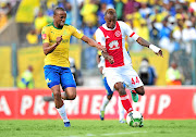 Yannick Zakri, right, tussles for the ball with Tiyani Mabunda during a Absa Premiership match between Ajax Cape Town and Mamelodi Sundowns.