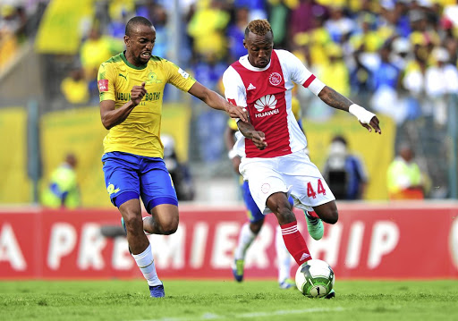 Ajax will rely on striker Yannick Zakri, right, to escape. He's seen here clashing with Tiyani Mabunda .
