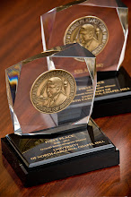Photo: 2010 and 2011 Hearst Journalism Awards overall national championship trophies (Photo by Steve Exum)