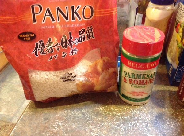 Then add the Panko, grated cheese blend, & both eggs & minced garlic.