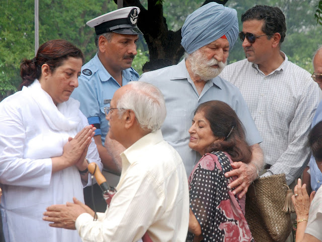 The photo published in The Tribune: IAF Marshal Arjan Singh with his daughter and son at the cremation of his wife Teji Arjan Singh in New Delhi on Sunday. Tribune photo: Manas Ranjan Bhui