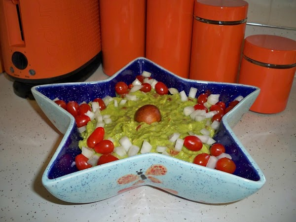 Put 2 avocado seeds at the bottom of your serving bowl and pour the...