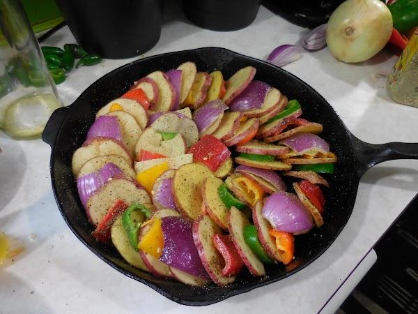 Start layering potato, veggie, potato, veggie in a ring around oven proof skillet. ...