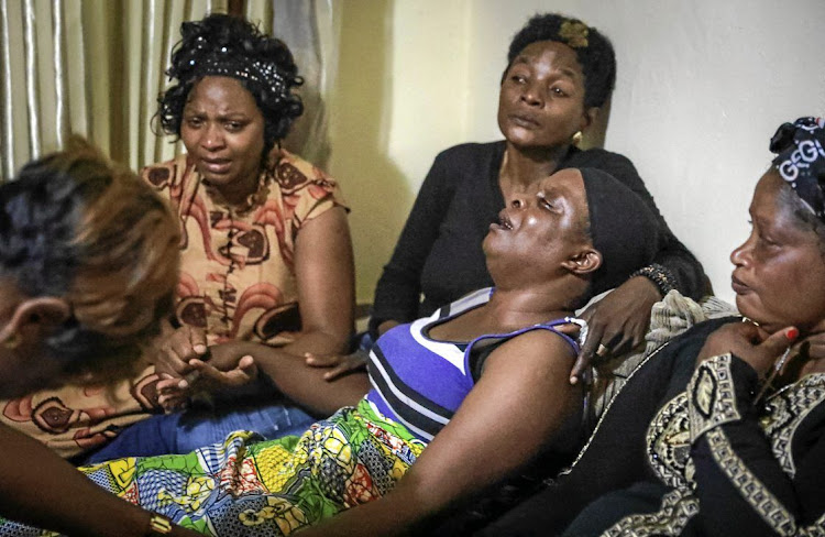 Antho Mpianzi, the mother of drowned Parktown Boys' High pupil Enock, is comforted by mourners on January 17 2020.