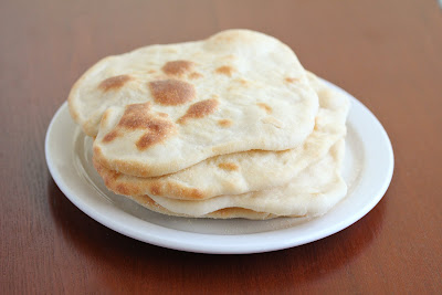 photo of a stack of naan