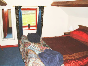 Photo: The Threshing Shed bedroom. This has sloping ceilings and  a kingsize bed.