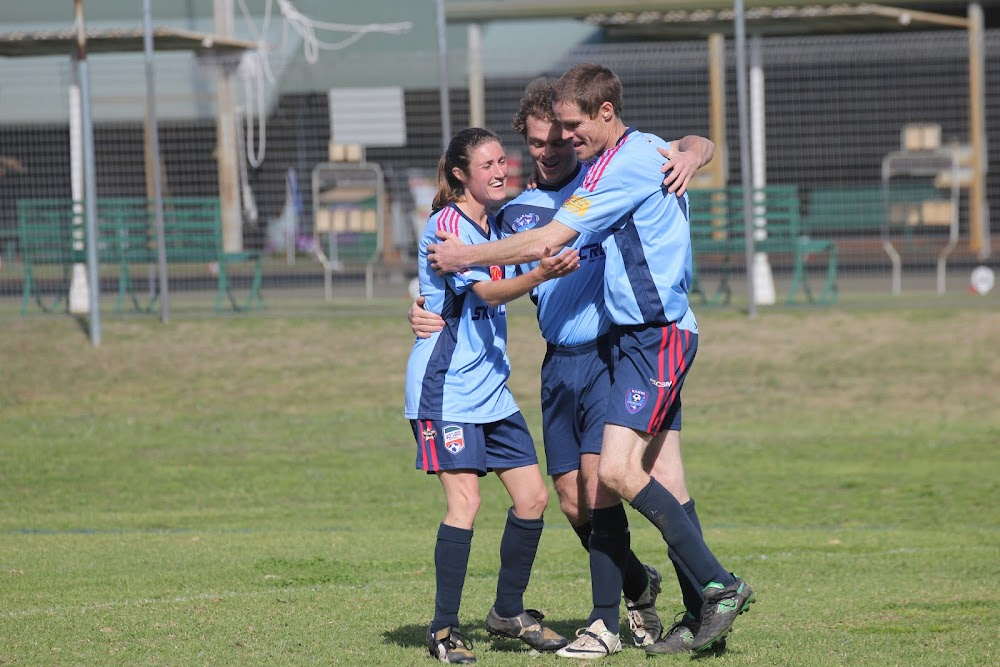 Warren Honeyman, middle, is congratulated by Angela Pattison, left, and Mick Sargent, right, after putting the Carps reserve grade side ahead 3-2 against Moree on Saturday. It went on to win 4-2 after Sargent scored the side's fourth.