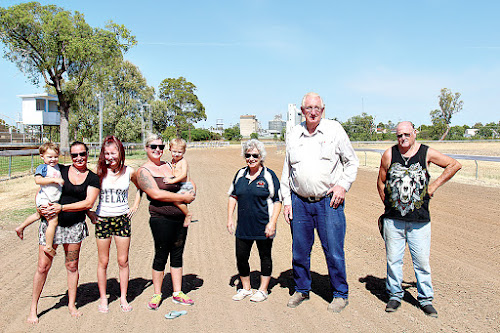 Narrabri Jockey Club rolled up its sleeves and got to work in preparation for this Saturday's race day, from left, Skye Redding holding Abel Redding, Zara Redding, Keiarnna Redding with Axel Redding, Cathy Redding, Bob Percival and Chris Manning.
