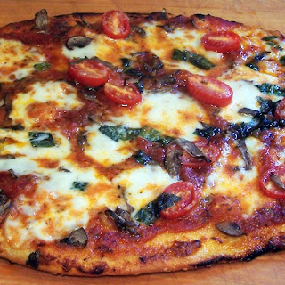 Fresh Mozzarella Tomato Basil and Mushroom Pizza.