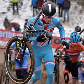 Uphill Difficulty by Marco Bertamé - Sports & Fitness Cycling ( 2017, orange, world championchips, 58, wheel, cyclo-cross, number, round, running, conter, luxembourg, uphill, roude léiw, mud, blue, ken, uci, brown, man, bieles,  )