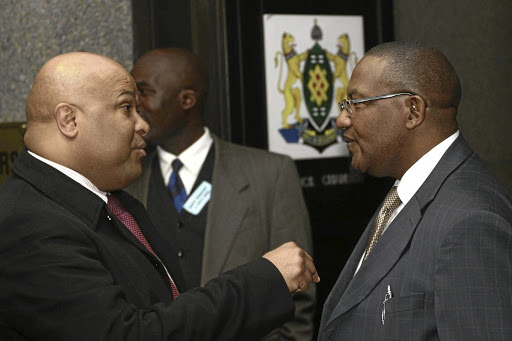 Former SSA director-general Arthur Fraser, left, claims 'blatant and deliberate falsehoods' were told at the state capture inquiry regarding alleged corruption under his watch. File photo.