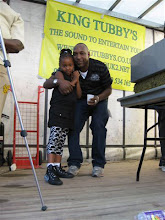 Photo: Cydney admiring her dad's D.J skills (Buckie)
