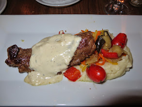 Photo: Flank steak with bleu cheese sauce, mashed potatoes, and a vegetable medly